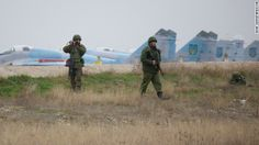 Russian soldiers aim a grenade launcher and machine gun as they guard positions at the Belbek air base on March 4.
