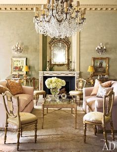 Music Room Sofas clad in a cotton-silk from Lee Jofa are grouped with a Nancy Corzine cocktail table in the music room; the shield-back chairs are French.