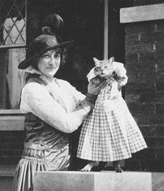 They had funny cat photos all the way back then, too! Ha!    cat dressed- Photographer: Unknown