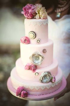 pretty pink wedding cake with gold metallic rose fondant and brooches