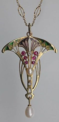 An Art Nouveau gold, plique-à-jour enamel, ruby and diamond pendant, probably Belgian, circa 1900. #ArtNouveau #pendant