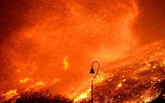 Strong winds kick up flying embers from the Solimar brush fire that started early Saturday morning in Ventura County, California