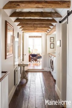 Wood Beams in a Hallway Bathroom {New England Farmhouse Maine Home + Design Magazine}