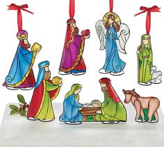 A set of 7 tin ornaments or standing pieces of the Nativity characters #stained #glass #nativity #Christmas #decor #burtonandburton #holy #family #Carolyn #Figuereo #art