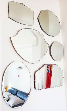 Mirrors - I'm doing this piece by piece on my bathroom wall... I have two, four to go! :) Its a work in progress.