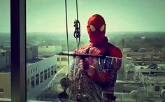 Awesome washers show up dressed like Spider-Man to clean the windows of a children's hospital. How cool is that?