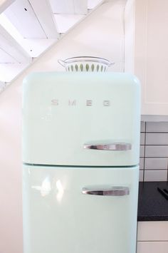 "Aqua refrigerator - though I can't get past the brand name ""Smeg"". It's like retro kitchen meets Red Dwarf."