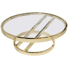 Circular Brass Coffee Table with Cantilevered Base by Milo Baughman   From a unique collection of antique and modern coffee and cocktail tables at https://www.1stdibs.com/furniture/tables/coffee-tables-cocktail-tables/