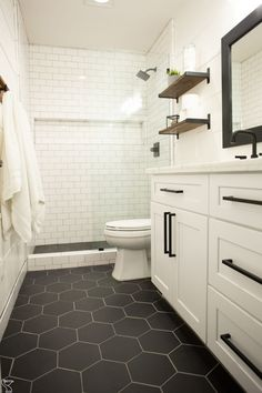 Modern Farmhouse, Rustic Modern, Classic, light and airy master bathroom design tips. Bathroom makeover a few ideas and master bathroom renovation a few ideas. Bathroom Grey, Bathroom Interior, Bathroom Vintage, Bathroom Mirrors, Showers For Small Bathrooms, Dark Floor Bathroom, Small Master Bathroom Ideas, Basement Bathroom Ideas, Hexagon Tile Bathroom Floor