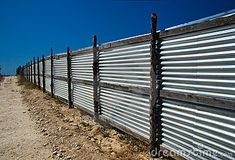 Corrugated metal fence by Alexander Solentsov, via Dreamstime