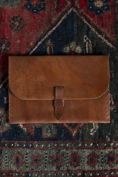 """$79 Handmade Leather """"Frontier"""" Clutch from Red Earth Trading Co. Differenct sizes and colors available. Holds an iPad! :)"""