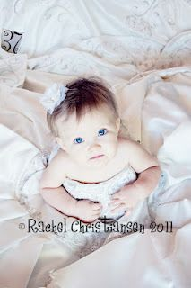 Baby girl in Mommy's Wedding dress <3 Cute if I never get my wedding dress sold!