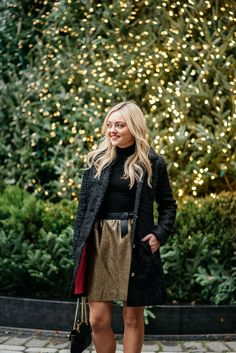 Bows & Sequins styling a black and gold holiday outfit: Sail to Sable sparkly tweed jacket, a black turtleneck, a gold tweed skirt with a bow belt, a Gucci Marmont bag, and Kate Spade glitter pom-pom heels!