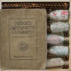 "Comparative Geography | encaustic, cut book, bottles, telescope on panels | 12 x 12 x 2"" | 2012    Shannon Newby   www.newbyart.com"