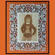Sara: Engraving photo on frame.