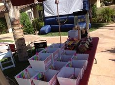 Outdoor movie theme birthday party. Popcorn boxes are the kids goodie bags filled with candy for the movie   # Pinterest++ for iPad #