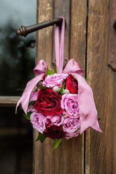 Pink %26 Red Flower Girl Pomander    Photography: Jared Platt Photography   Read More:  http://www.insideweddings.com/weddings/classic-arizona-wedding-of-denver-broncos-nfl-player-brock-osweiler/701/
