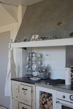 FARMHOUSE – INTERIOR – early american decor inside this vintage farmhouse seems perfect in this kitchen.
