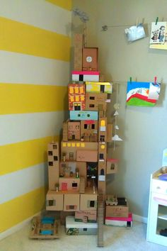 Nessadee Art + Life created this incredible box house using a ton of boxes in different shapes and sizes, a hot glue gun, packing tape, scissors, and markers. Feel free to let your kids add as many embellishments (string, felt, moss, and more) as they'd like.  Source: Nessadee Art + Life