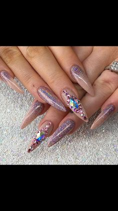 Nude acrylics with pink holo glitter and gems c/o Nails by Hollie...bit long for me but stunning.