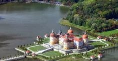 Moritzburg Castle is a Baroque palace in Moritzburg, in the German state of Saxony, northwest of the Saxon capital, Dresden. The castle has four round tow