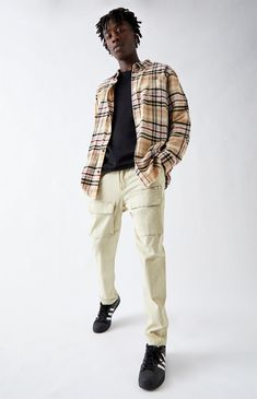 """Stay on-trend in these street-style-approved pants by PacSun. The Utility Beige Front Pocket Slim Cargo Pants have a soft twill fabric with stretch, pockets throughout, and a versatile slim fit. FIT Slim fit Sits below waist Comfortably slim through the thigh Close to the knee and straight to the ankle 10 5/8"""" front rise Explore more fits using our Denim Fit Guide FABRICATION + CARE Beige wash pants Twill fabric with stretch Front and back pockets Cargo pockets Exposed zipper pocket Elastic wais Trendy Outfits, Teen Boys Outfits, Dope Outfits, School Outfits, Summer Outfits, Teen Guy Style, Boys Clothes Style, Teen Boy Clothes, Cargo Pants Outfit Men"""