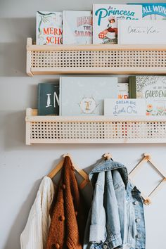 It took us under 30 minutes to DIY all three shelves and hang them. It cost us under 30 Dollars per cane shelf. Wall Storage Shelves, Nursery Shelves, Ikea Shelves, Ikea Kids Bedroom, Ikea Nursery, Nursery Nook, Ikea Bookshelf Hack, Bookshelves Kids, Bookcases