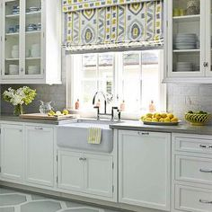 House Beautiful - kitchens - roman shade, creamy, white, glass-front, kitchen cabinets, gray, quartz, countertops, farmhouse, sink, paneled dishwasher, gray, geometric, floors, marble, tiles, backsplash, yellow and gray design, yellow and gray room, yellow and gray kitchen, gray hex floor, Kravet Thom Filicia Prospect - Shadow,