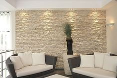 Interior Stone Veneer for the Public Area of the House : Interior Stone Veneer Cream Stone Wall Black Sofas White Seating Pads White Carpet