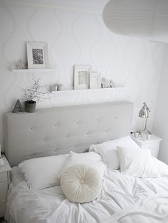 This grey headboard is nice too. The shape could tone down the girly-girl factor a bit. And I like the white shelves. I would just use one shelf, and put a colorful print (the Audobon flamingo), some books and pictures in silver frames on it. Also a vase in a bright pop of color…maybe teal?