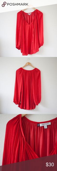 """[Jennifer Lopez] Red Blouse Item is in brand new condition. No holes or stains. Very minor flaws will be pictured if any. See photos.   Approximate flat measurements:  Length: 30.5""""  Pit to Pit: 26.5""""  I do my best to describe items accurately. Any flaws are noted and photographed. Please see measurements for sizing.  F2 Jennifer Lopez Tops Blouses"""