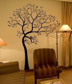 Tree painted on wall. Love the simplicity and the natural warm, earth tones of the room.
