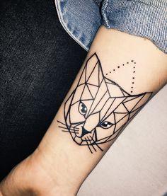 Geometric cat tattoo on forearm.