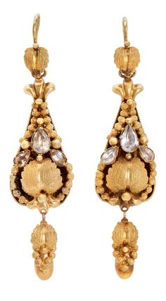 A pair of mid Victorian 18K yellow gold drop earrings comprised of textured leaves and spheres surrounding a cluster of teardrop-shaped closed-back aquamarine stones. Circa 1860.  (Via 1stdibs.)