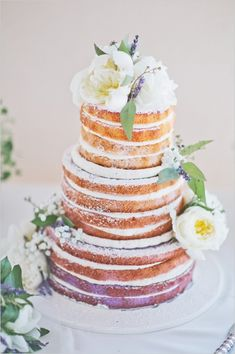 Lavender naked wedding cake with floral topper. Cake Design: Sugar Bakeshop --- http://www.weddingchicks.com/2014/06/10/moms-wedding-shoes-wedding/