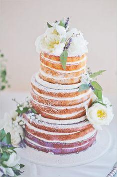 Lavender naked wedding cake with floral topper. Cake Design: Sugar Bakeshop --- http://www.weddingchicks.com/2014/06/10/moms-wedding-shoes-wedding/