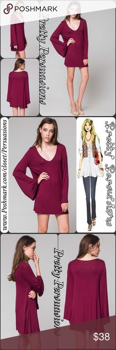"""NWT Long Bell Sleeve Wine Tunic Mini Dress NWT Long Bell Sleeve Wine Tunic Mini Dress  Available in sizes S (M & L sold out) * Small will fit a S/M fine as well * Measurements taken from a small  Length: 31"""" Bust: 38"""" Waist: 42""""  Rayon/Spandex  Made in the USA  Features  • long bell sleeves  • stunning deep wine color • rounded plunging v-neckline  • úber soft material (seriously, you'll want to live in this😍) • relaxed fit  Bundle discounts available  No pp or trades  Item # 1/29300380WPB…"""