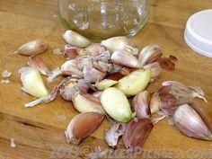 GARLIC AND HONEY Shake garlic skins loose in a jar.