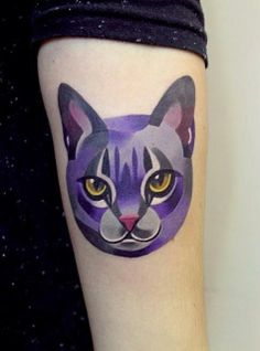 "A cat tattoo designed by St. Petersburg-based Instgrammer ""Sasha Unisex."""