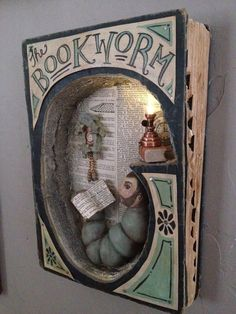 """The Bookworm"" by Tammy Smith, book art diorama Shadow Box Kunst, Shadow Box Art, Art Altéré, Altered Book Art, Altered Tins, Handmade Books, Handmade Journals, Handmade Rugs, Handmade Crafts"