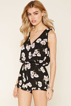 Style Deals - A sleeveless woven romper with an allover floral print, a snap-button surplice front, an elasticized waist, and a ruffled hem.
