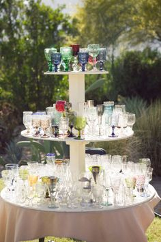 thrift store wine glass wedding | Photo by Marianne Wilson / Image via Style Me Pretty .