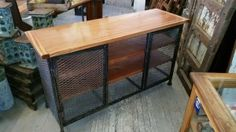 Industrial media console with steel framing and expanded metal grating.  Complete with two full length inside shelves and working double doors.  Perfect for a giant flat screen tv and all your dvds or use in a kitchen or office for storage. Made to order.