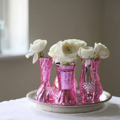Grouping of mercury pink vases for wedding centrepieces available from @theweddingomd