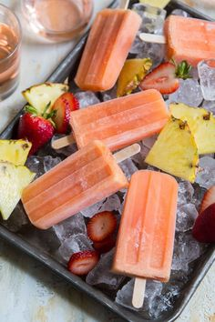 These passion fruit rose popsicles are fun and tasty way to cool down during the summer. Rose wine is blended with passion fruit, pineapple, and strawberry. Wine Popsicles, Homemade Popsicles, Slushies, Frozen Desserts, Frozen Treats, Fruit Rose, Parfait, Healthy Popsicle Recipes, Gelato Shop