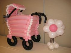 Old fashioned 3-ft tall baby pram Table Topper, with flower centerpiece. www.HollyNagel.com