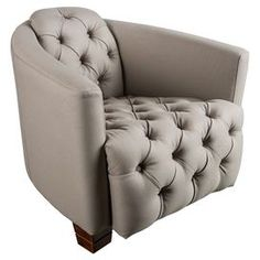 "Featuring a low seat and raked back, this richly tufted arm chair offers stylish appeal for your living room or den.   Product: ChairConstruction Material: Cotton and woodColor: TaupeFeatures:  Button-tuftedBlock feetLow seatRaked back Dimensions: 29"" H x 34"" W x 32"" D"