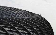 Laborers work on the roof of a building under construction in Beijing, on July 13, 2012.