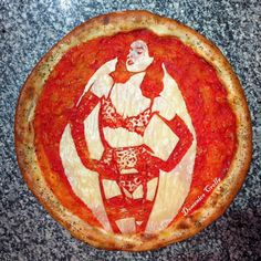 """Domenico Crolla posted this full-body pizza portrait of burlesque dancer Dita von Teese to Twitter, who replied """"wow!"""" to the intricate work of art."""