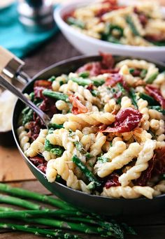 This Asparagus Lemon Cream Pasta with Crispy Prosciutto from Some the Wiser is a light, flavorful dish that is perfect for a summer weeknight meal your whole family will enjoy.
